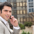 Young man having conversation on phone — Stock Photo