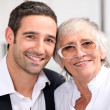 Stock Photo: Adult son and his aging mother