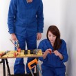 Plumber and his female apprentice — Stock Photo