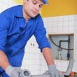 Stock Photo: Plumber installing water pipes