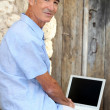Man using his laptop outside - Foto de Stock