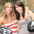 Young female cyclists — Stock Photo