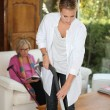 Daughter cleaning for mother — Stock Photo