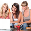 Young women watching a film on a laptop - Photo