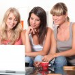 Young women watching a film on a laptop - Stock Photo
