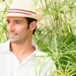 Man surrounded by tall grass — Stock Photo