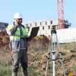 Surveyor on site with a laptop - Stock Photo