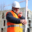 Surveyor on construction site — Stock Photo