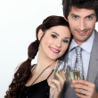 A couple toasting sparkling wine glasses — Stock Photo #7377554