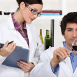 Testing wine in a laboratory — Stock Photo