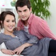 Young couple laying on couch — Stock Photo