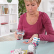Stock Photo: Grumpy womtaking her pills