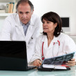 Male and female doctors with laptop — Stock Photo #7378326