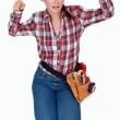 Craftswoman kneeling and clenching her fists — Stock Photo