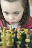 Little girl playing chess — Stock Photo