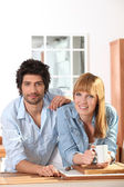 Couple having a coffee in a kitchen — Stock Photo