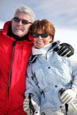 Couple of elders wearing ski glasses at ski — Stock Photo