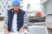 Construction worker looking at his plans — Stock Photo