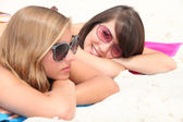 Portrait of two girls on the beach — Stock Photo