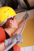 Female electrician with cables — Stock Photo