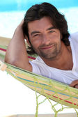 Man at beach laid in hammock — Stock Photo