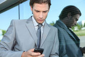 Young executive using a mobile phone — Stock Photo