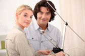 Couple with a television antenna — Stock Photo