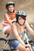 Two girls riding bikes — Stock Photo