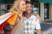 Couple on a shopping spree — Stock Photo