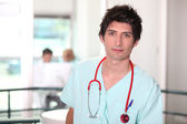 Hospital medic in scrubs with stethoscope — Stock Photo