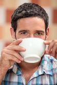 Man drinking from a bowl — Stock Photo