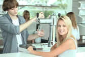 Young woman getting admiring glances from the barman as she waits for a dra — Stock Photo