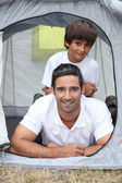 Father and son in a tent — Stock Photo