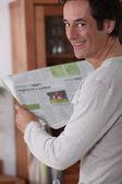 Man happy reading newspaper. — Stock Photo