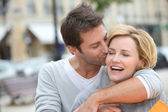 Husband kissing wife — Stock Photo