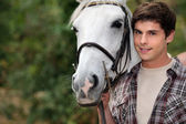 Teenager with a horse — Stock Photo