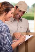Man delivering parcel — Stock Photo