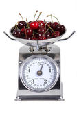 Scale measuring the weight of a bunch of cherries — Stock Photo