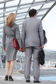 Business couple arriving at airport — Stock Photo