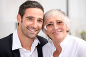 Adult son and his aging mother — Stock Photo