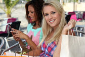 Two woman on shopping trip — Stock Photo