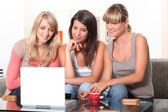 Young women watching a film on a laptop — Stock Photo