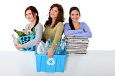 Three young women recycling — Stock Photo