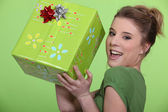 Woman in green with a gift — Stock Photo