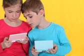 Two kids playing video games. — Stock Photo