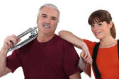 Tile cutter with female colleague — Stock Photo