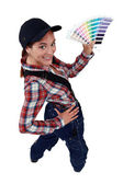 Craftswoman holding a color chart — Stock Photo