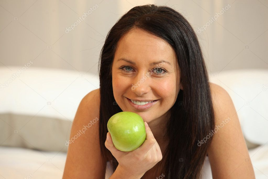 A woman eating an apple  Stock Photo #7372826