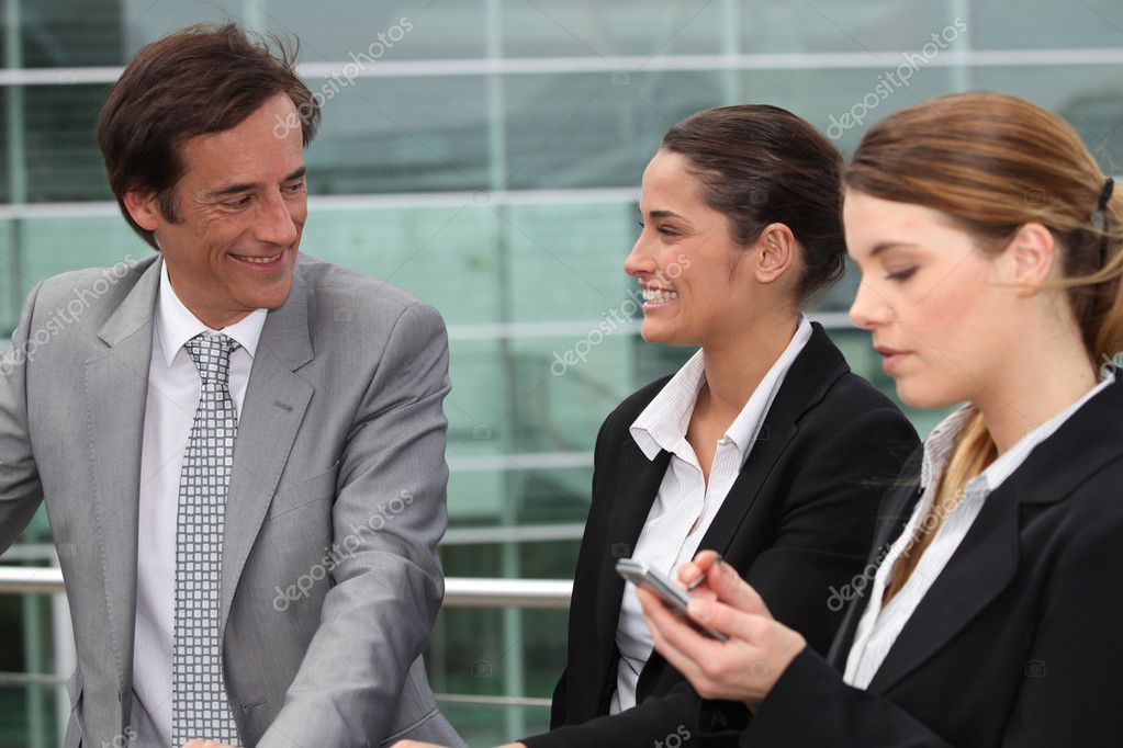 Three business stood outside workplace — Stock Photo #7374955