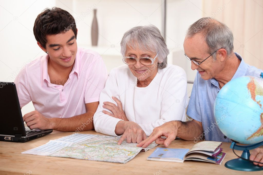 Family looking at a map — Stock Photo #7375252